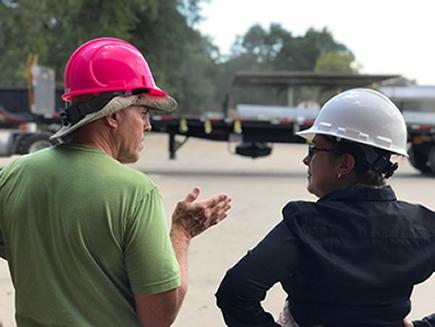 Rochelle Stoddard speaking to an employee