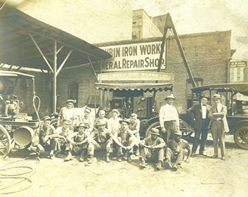 Employees standing in front of the original Rubin Iron Works building over 100 years ago.