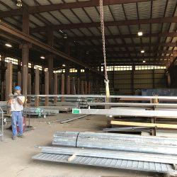 A Berman employee loading galvanized steel onto a rack